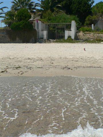 Villa vacances face plage de Nora Pula Sud Sardaigne