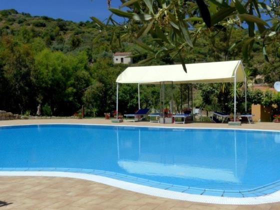 Holiday rentals Sardinia Budoni Residence with swimming Pool, waterfront Holiday Apartment