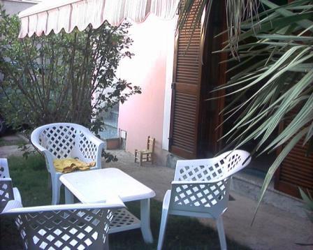 Casa Vacanza Trilocale con Giardino Wifi a Pula