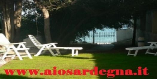 Villa vacances Pieds dans l'eau face plage de Nora Pula Sud Sardaigne,